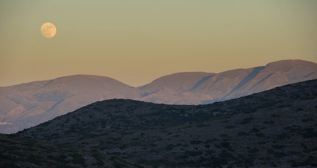 Moon rises above Crete, Greece
