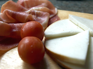 Serrano ham and smoked cheese; classic tapas dishes