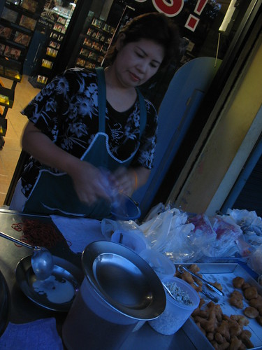woman selling chinese donuts