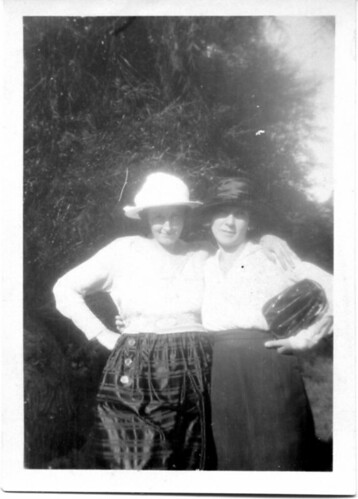Two women wearing hats