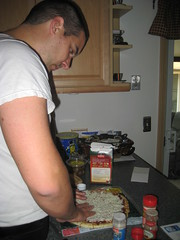 Dan prepping a pizza