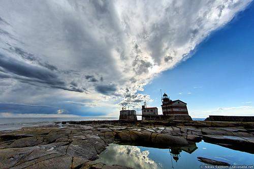 Clearing Skies Above Märket Lighthouse by taivasalla