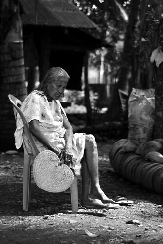 An elderly woman rests on a chair Saranggani Mindanao Philippines Buhay Pinoy  Ngayon Filipino Pilipino  people pictures photos life Philippinen