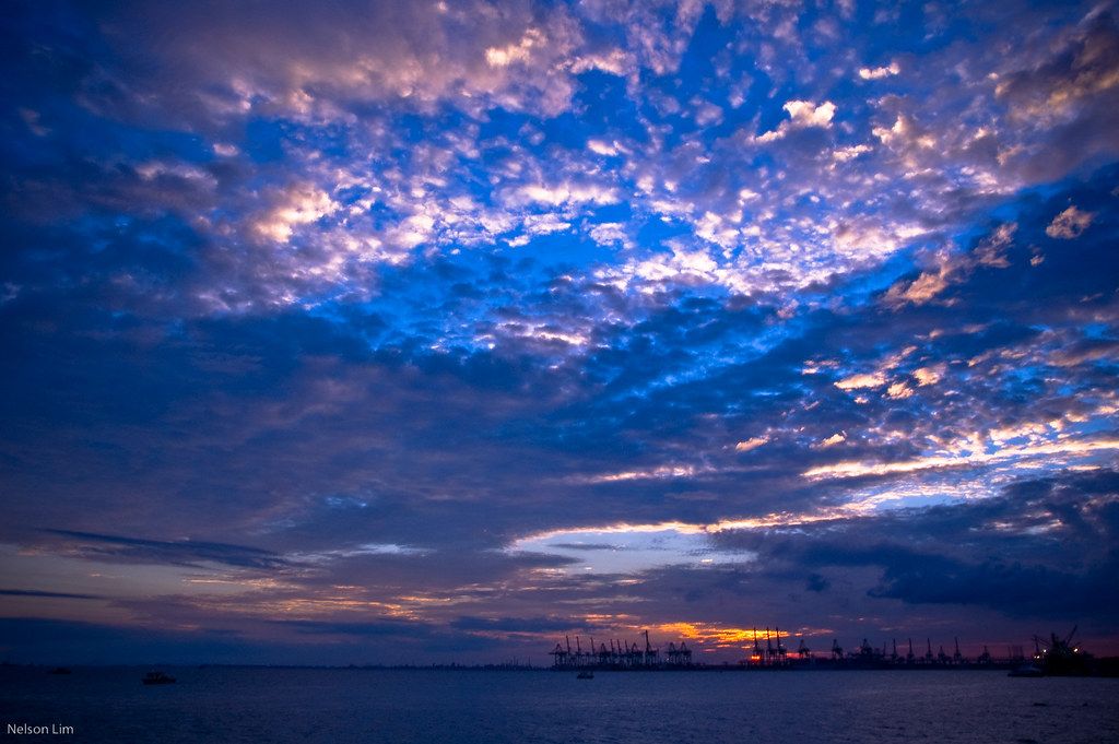 Sunrise and sunsets have always captured my heart. Its stunning to see how amazing God causes not only the sun to rise and set, but to make it such a beautiful sight. It need not be beautiful, but He made it so beautiful perhaps for us? This photo was taken in 2007 at Labrador Park with a group of friends. In this photo I found the sky more interesting then the sun itself.