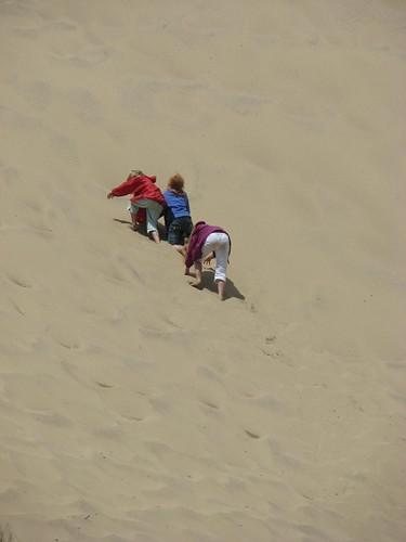 Emily, Laura and Elizabeth climbing the dune