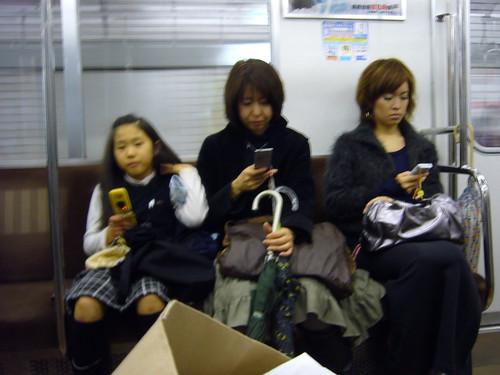 Threee generations of texting, Tokyo subway