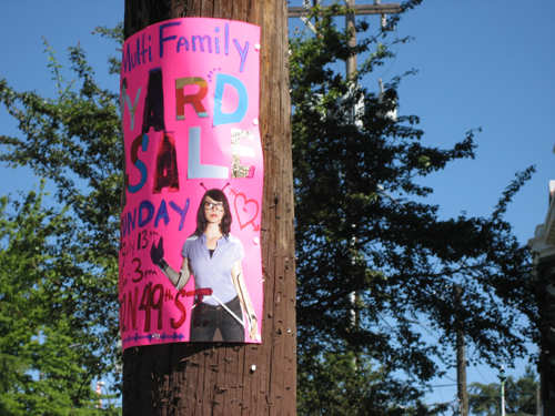 Collaged yard sale sign
