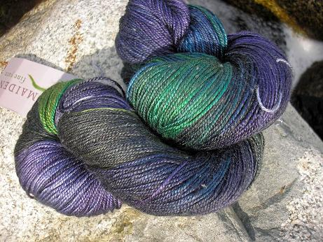 Photo of Handmaiden Sea Silk yarn in dark greens, blues, and purples