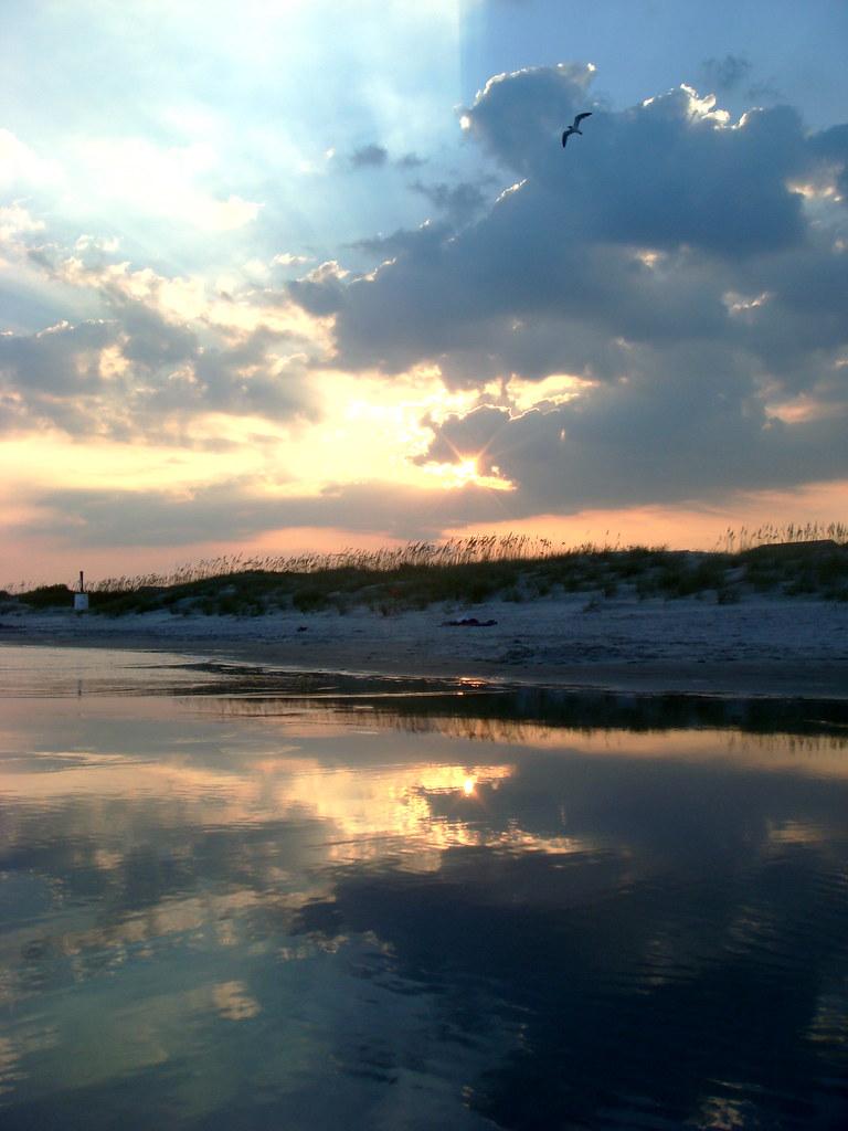 Sunset on the beach, three