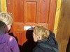 loiterers look through letterboxes in derelict buildings