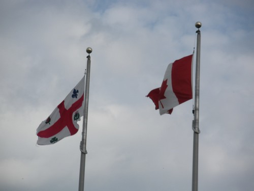 Flags of Montreal (left) and Canada (right)