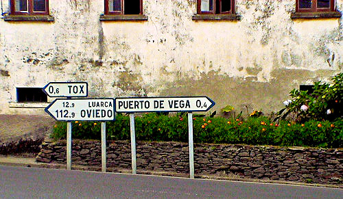 Road Signs at intersection in Santa Marina, Spain