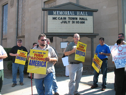 A group of AFL-CIO union members gather outside the site of a McCain townhall meeting