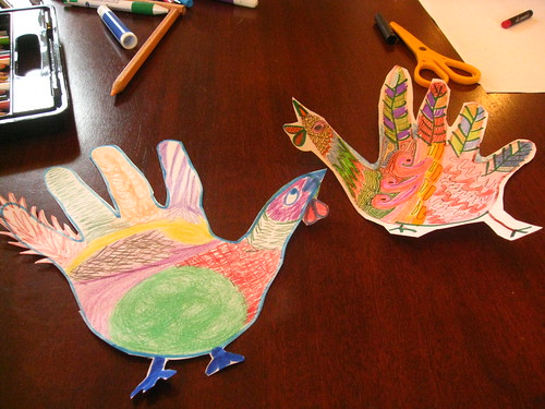 "A photograph of two ""hand turkeys"" cut out of construction paper."