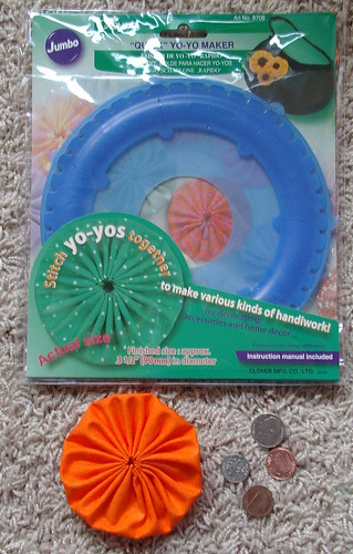 jumbo yoyo tool and you and reference of size with coins
