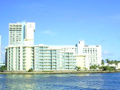 view of Caribe Hilton taken from the bridge across the lagoon