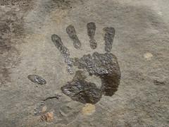 wet hand on rock - Spain Fraile river