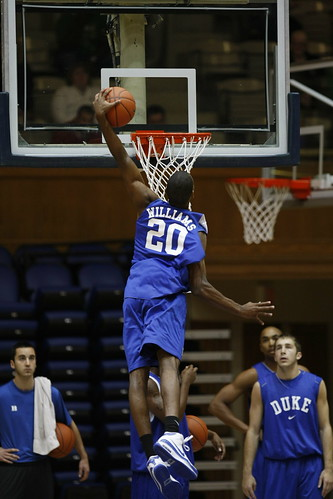 Freshman Elliot Williams soars for a dunk in Dukes open practice Friday. Photo by Chase Olivieri/The Chronicle