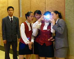 a group of school kids, take a picture at the camera