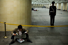 Best guarded newspaper reader - Beijing, China