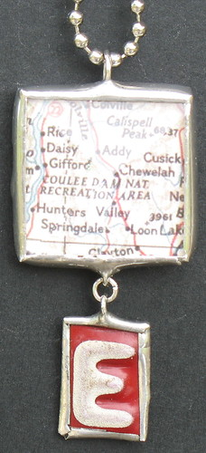 side one of map charm w/hanging monogram