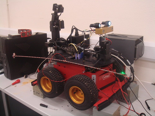 The devbot rover with arm and PTU/camera/headlights attached.  The combined unit did a great job of illuminating and videoing our lab!