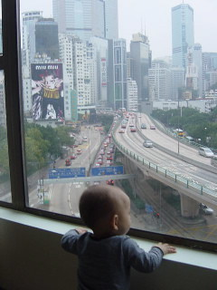 Mitchell watches the world of Hong Kong go by.