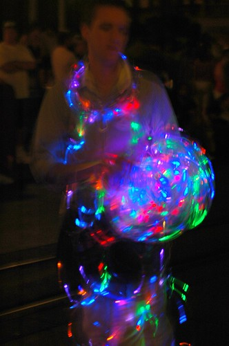 a person selling lights at the electric parade at disney world
