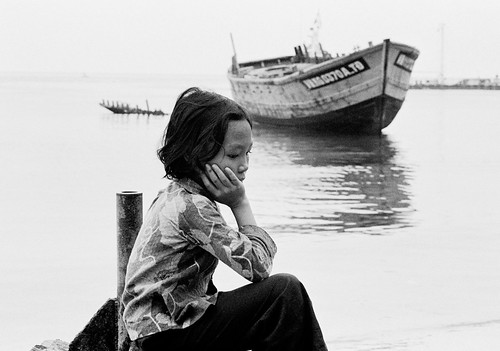 A young Vietnamese refugee resting at the Pulan Bidong refugee camp in Malaysia.
