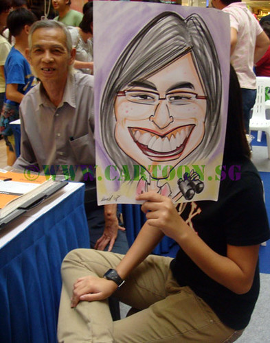 Portrait artist and caricature artist trainee at caricature booth