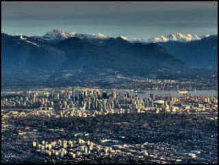 Aerial approach to Vancouver showing, Richmond, Kitsilano, Downtown, Coal Harbor and the North Shore mountains.