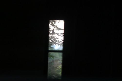 through the barn at sunset