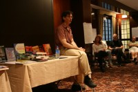 Alfie Kohn sitting in the classroom library