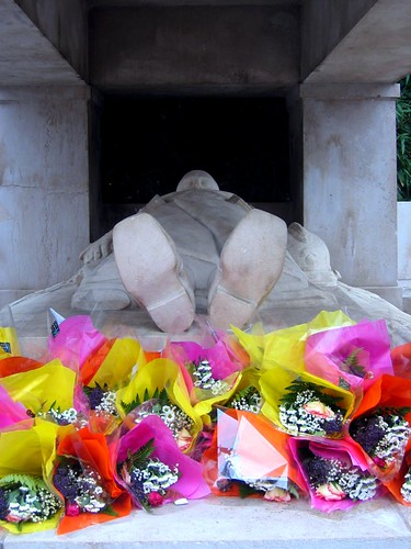 Flowers at the feet of the WWI memorial in Valence.