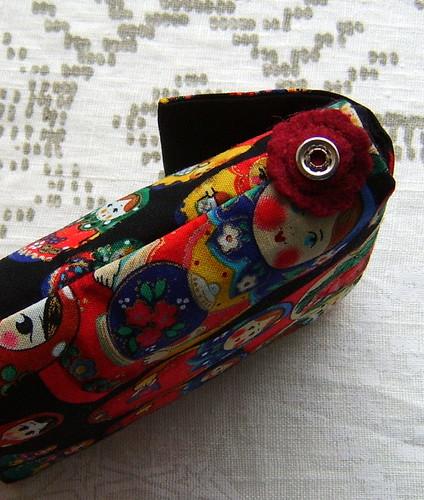 Flower felt detail on matryoshka doll little bag