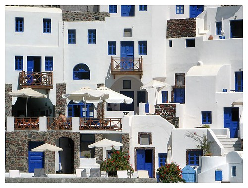 White-washed houses with blue doors and windows by you.