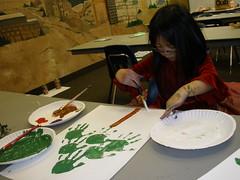 Olivia Making a Handprint Christmas Tree