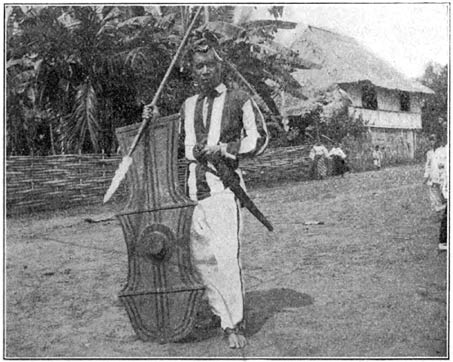 men in traditional costume Philippine old pictures photograph black and white Philippines Buhay Pinoy Filipino Pilipino  people photos life Philippinen road spear shield dagger dirk weapons