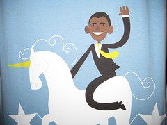 Barack Obama riding a unicorn on a pedestal