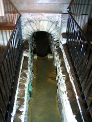 Original Roman drain, draining hot spring water from the baths, into the River Avon, Roman Baths, Bath, UK