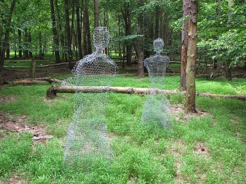 strange figures in the woods