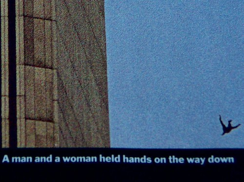 """A man and a woman held hands on the way down."""