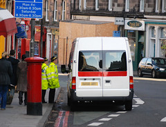 Van in bus lane with traffic wardens