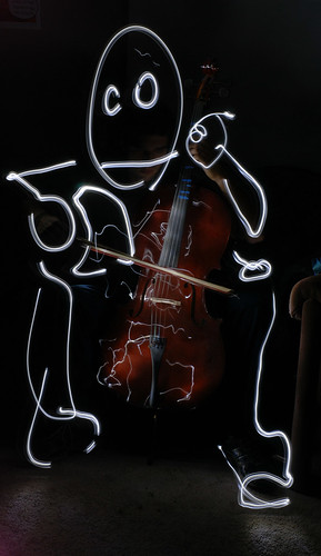 Light man playing cello