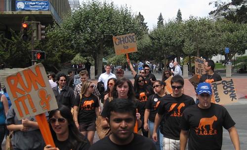 The T.I.G.E.R. team marches down Telegraph Avenue.