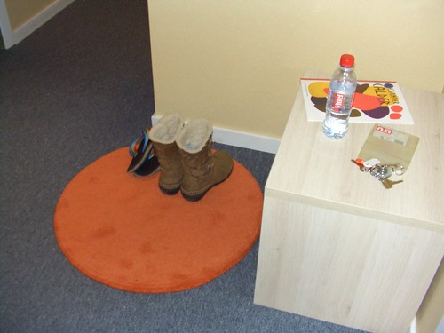 Orange rug . . . a necessity  Sticker book a christmas present from SaraToday, boots a birthday gift from Keiko, flip flops a gift from Robert from Ailey many years ago.