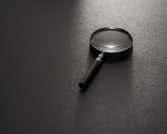 Magnifying glass and reflection