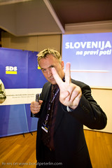 Jonas Žnidaršič a celebrity in a role of journalist showing different combination of fingers on Parlamentarial elections 2008 in Slovenia._3074