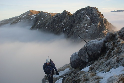 Juggs moving up Stob Coire Leith...the pinnacles of the Aonach Eagach now a memory