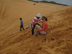 Carrie sand sledding at the sand dunes of Mui Ne